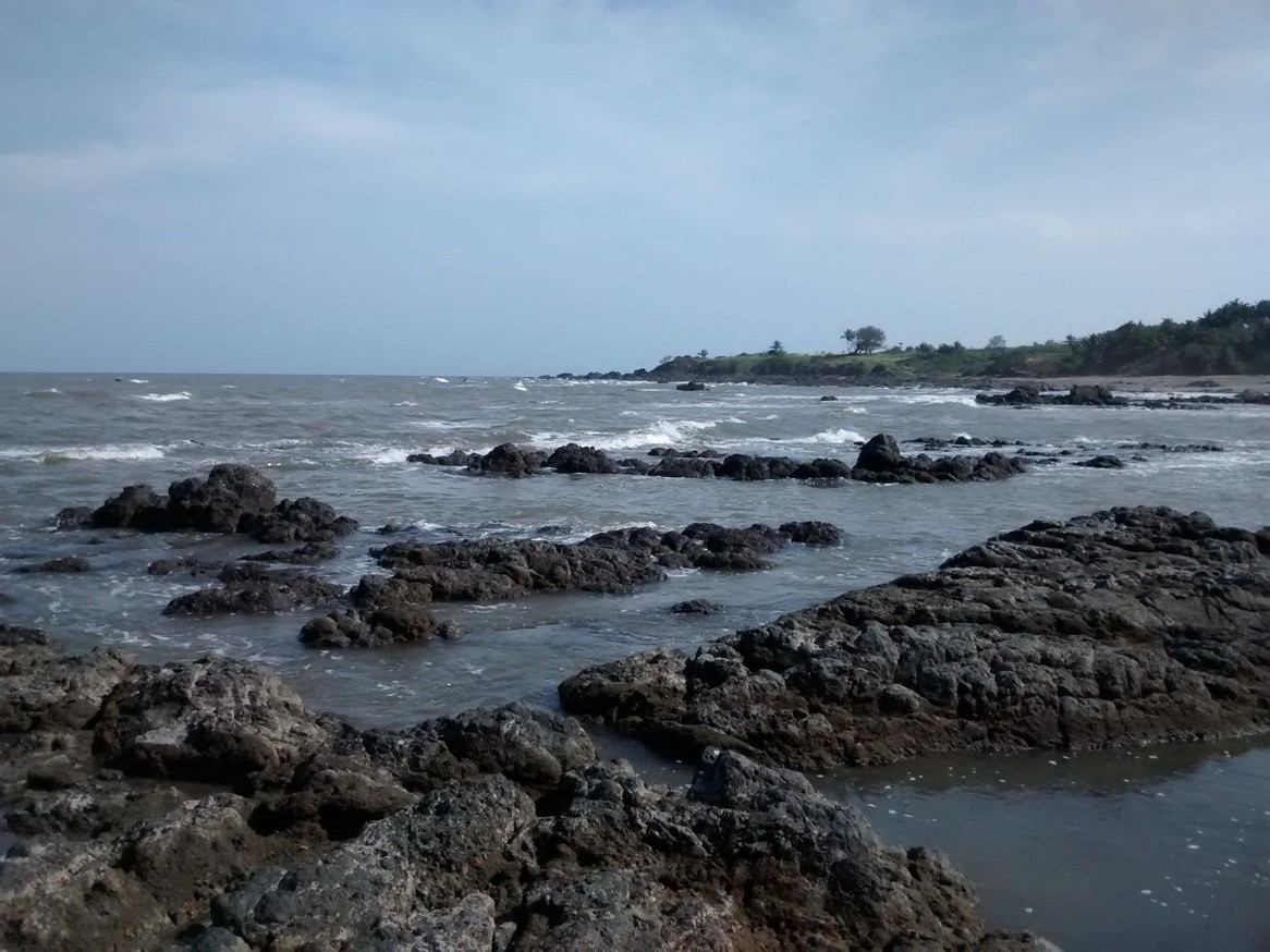 The beach was gorgeous. The tide was coming in and the waves had started to smash into therocks.