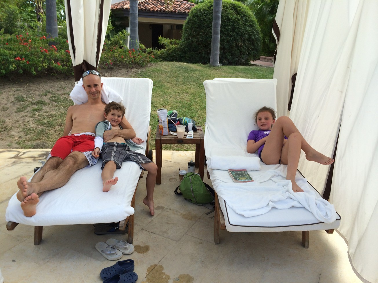 Lounging in our cabana while the fresh application of sunscreen sets in.