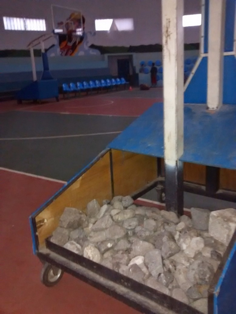 Weigh down the portable basketball goals with weights, I mean rocks.