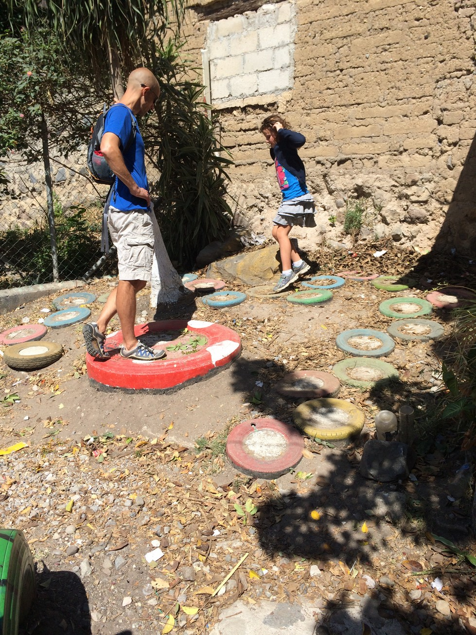 Used tires, painted, filled with cement and buried makes for some creative games in a park
