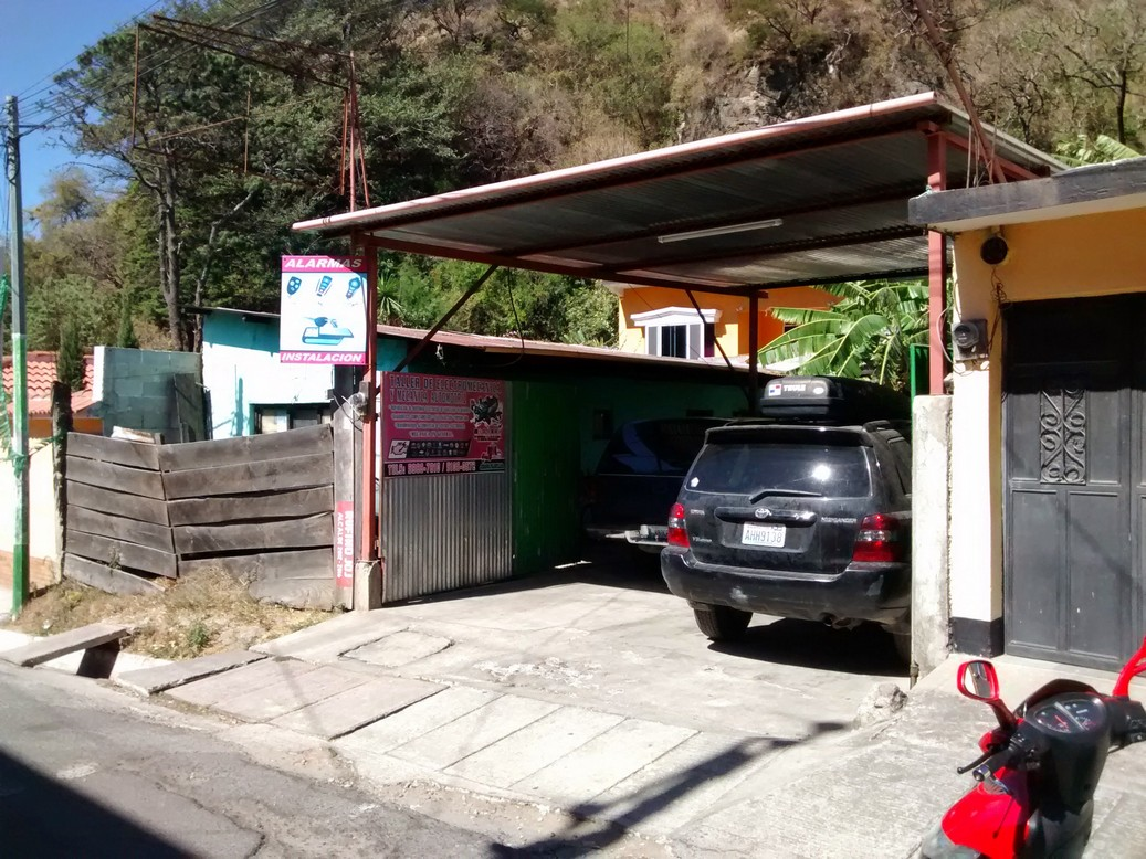 That's my car parked inside my mechanic's garage. You are looking at his entire shop. It's basically a car port with a sign advertising car alarm installations.