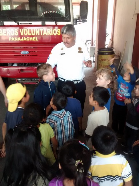 The Chief of the Panajachel Bomberos welcoming students from the LIFE School.