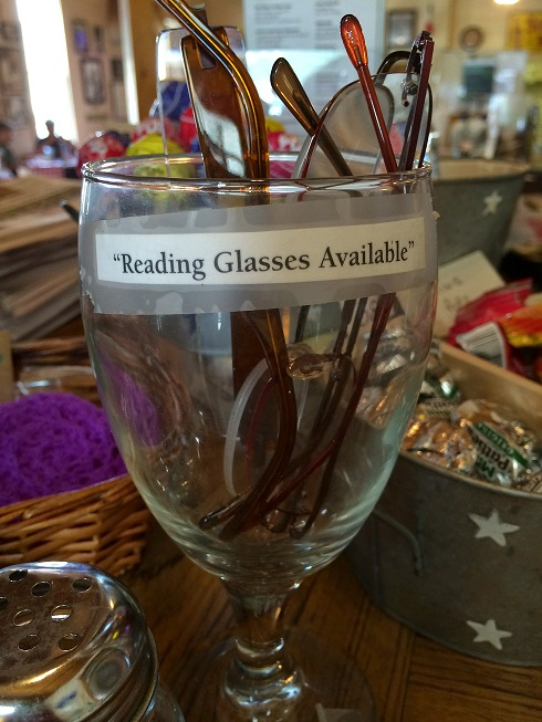 If you'd care to borrow some reading glasses while dining at this deli in Texas.,you can...but really, would you?