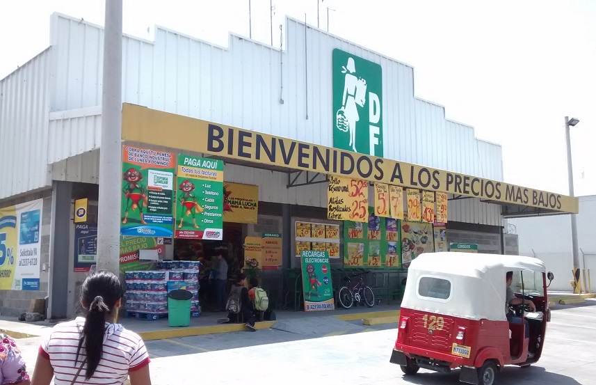 """The Panajachel Dispensa (our almost grocery store). This is one of the few stores in town with a parking lot and free bathrooms.The slogan on the yellow awning reads """"Welcome to the lowest prices"""". Sounda little familiar?"""