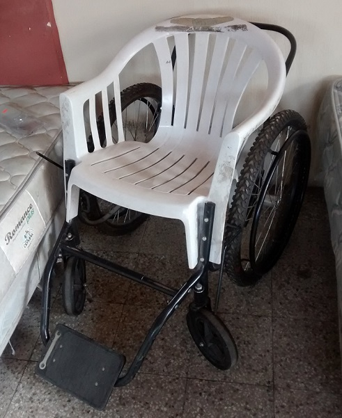 Apparently if you cut the legs off of a plastic lawn chair it will fit perfectly on a wheel chair base.