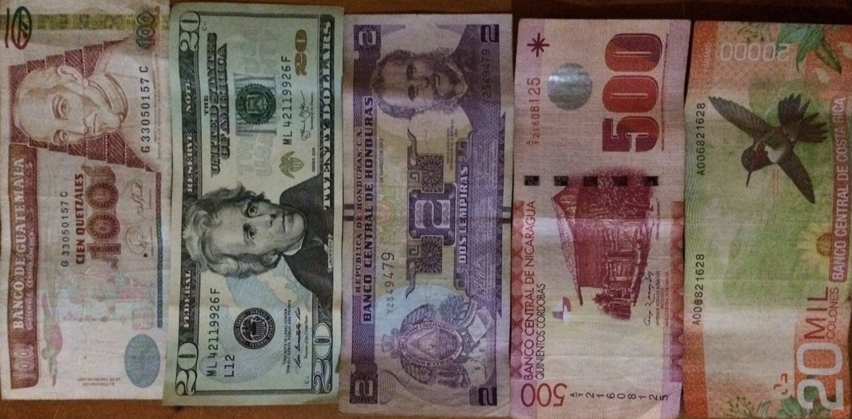 Paper notes from all five countries.From left to right:GuatemalanQuetzal, value = $13US.El Salvador exclusively uses the US Dollar.HonduranLempira, value = .09 US.NicaraguanCordoba = $18 US.Costa RicanColones = $37.50