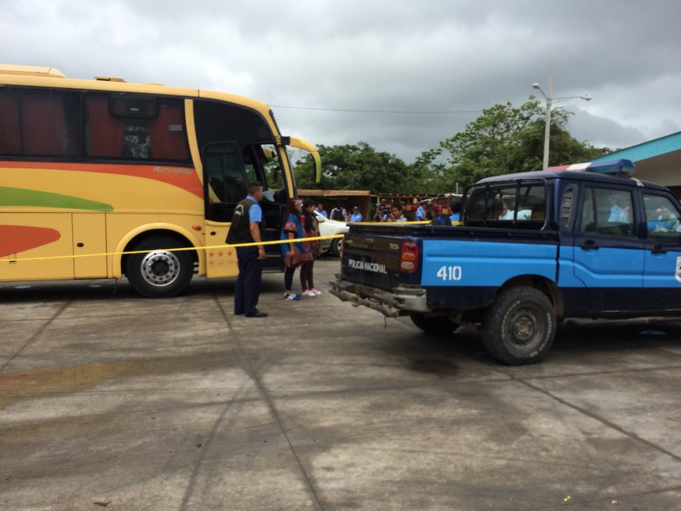 Look closely - These two girls standing in front of the bus doors were caught transporting cocaine across the border into Nicaragua. Apparently, the cocaine is strapped around their middles and covered by the big shirts.