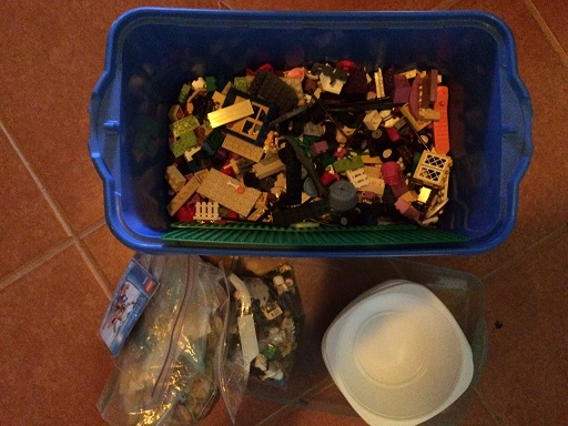 We're down to one bin that isn't full to the rim. We have room for some bowls (that we used for sorting the Legos), a baggie of characters for each kid and one set with directions for each kid too. Everyone is happy.