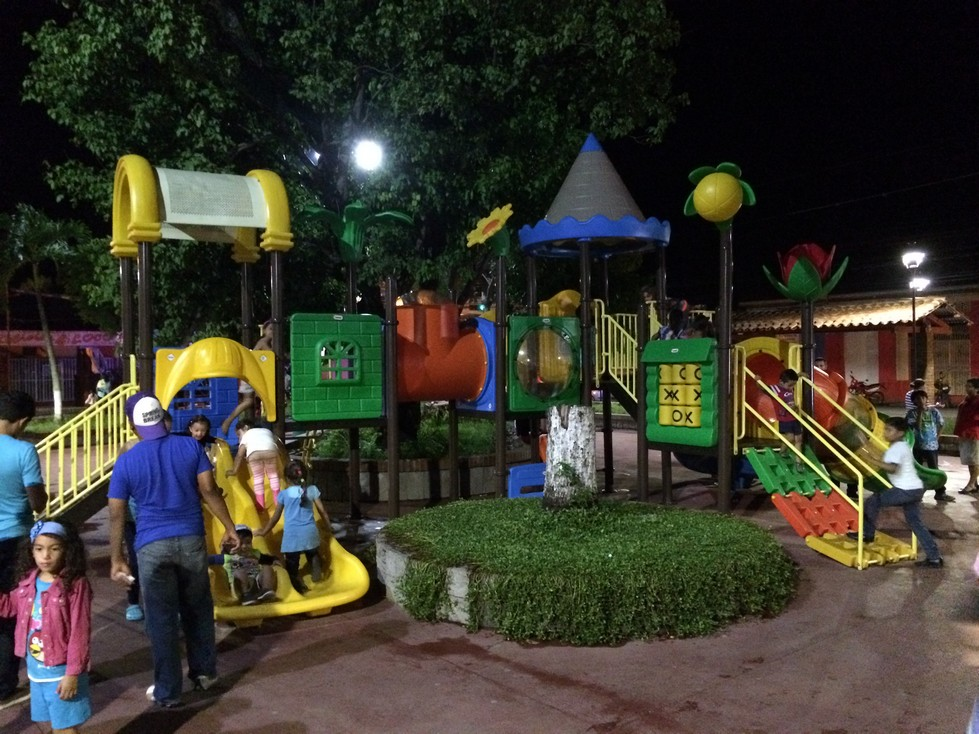 The playground! It's not unusual for Ela and Tag to join other children playing tag and other games at the park.