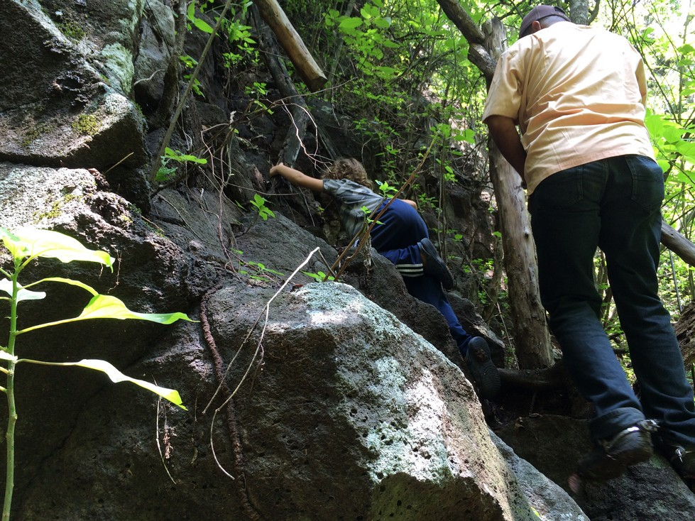 The climb down, and later back up, the waterfall was steep. Tag is literally pulling himself up over the rocks.