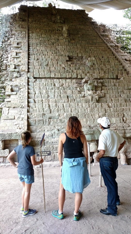 Ela, Mick and Raul study the stairway full of glyphs