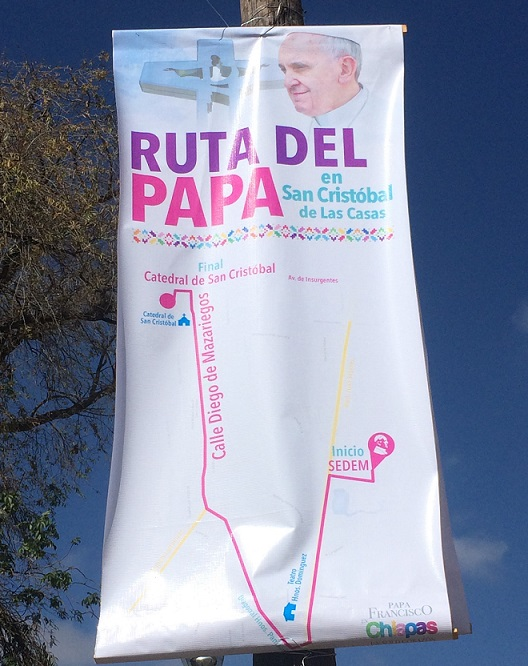 The route of the Popemobile was hung prominently on telephone polls and light posts throughout town.