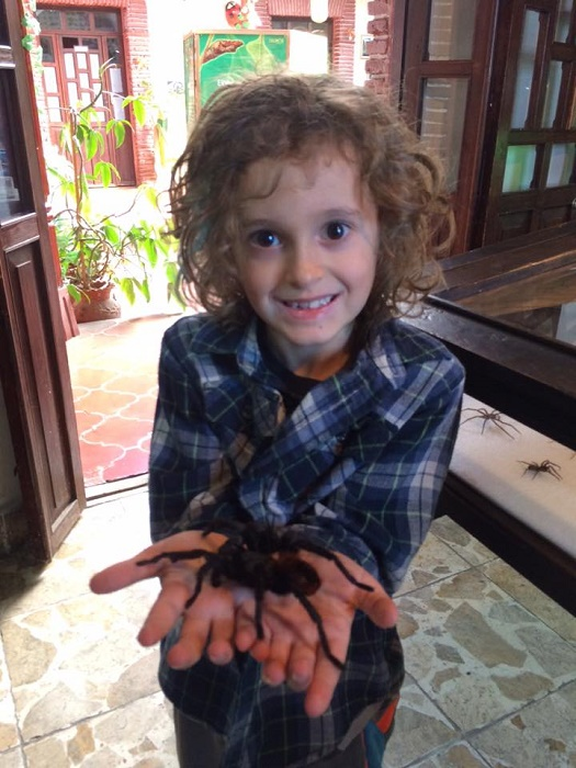 Tag and his furry friend, the tarantula. Yes, it was alive.