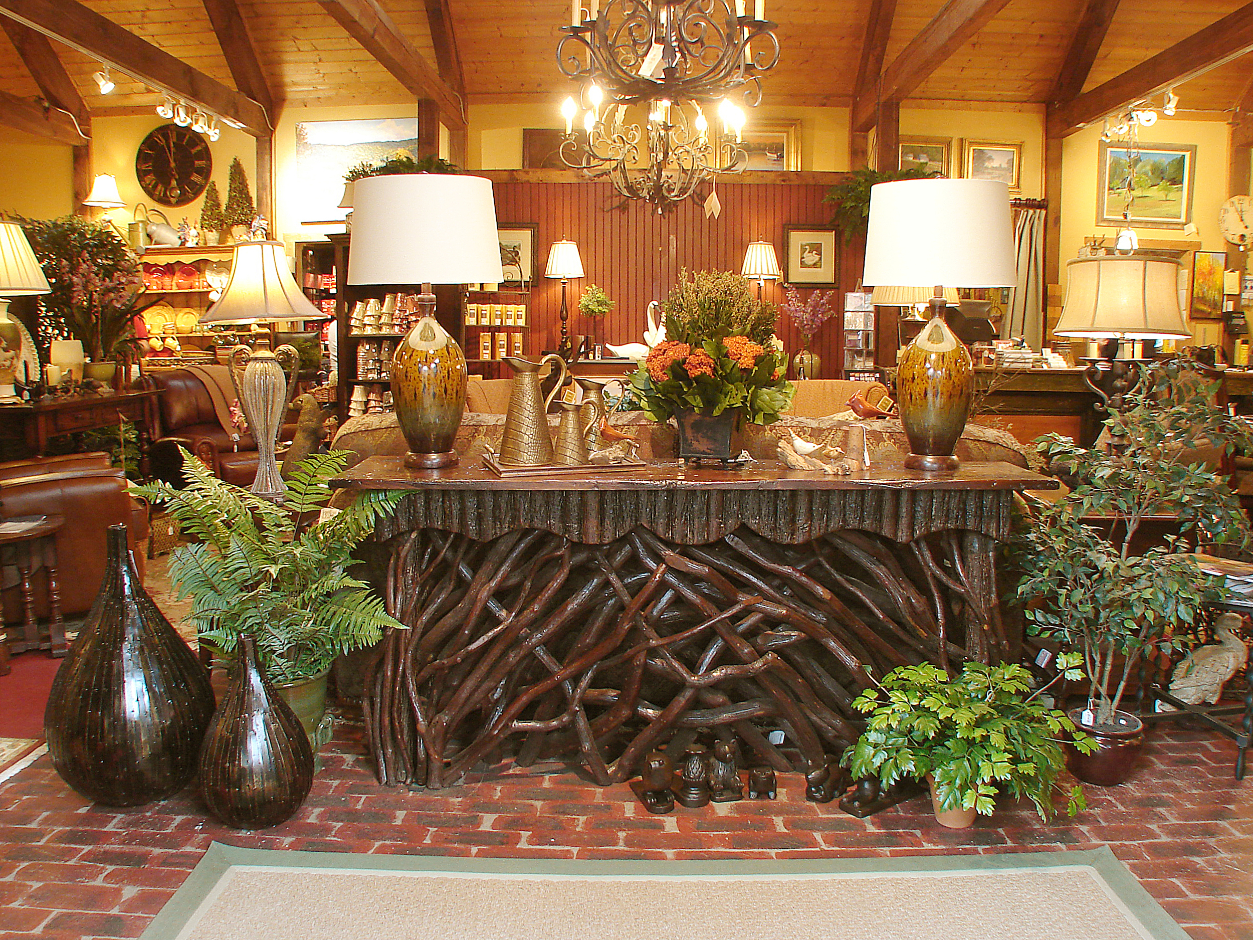 Rustic mountain furnishings are hand crafted with local materials by Tiger Mountain Woodworks, an exclusive line carried only by The Summer House.