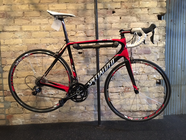 2014 Specialized Tarmac Comp     The Tarmac doesn't just do one thing well—it does everything exceptionally. Its perfect combination of complete performance has already won all three Grand Tours, and it will take both your racing and riding to the next level. Size 58cm. Call for pricing.