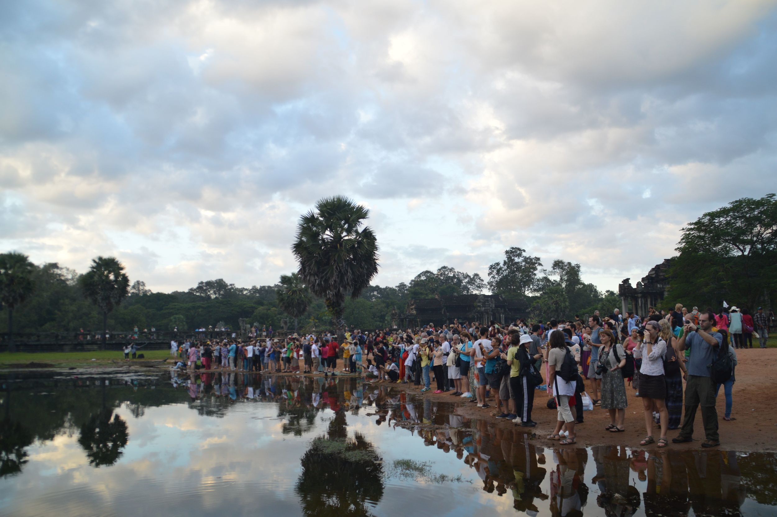 an overcrowded Angkor Wat at dawn