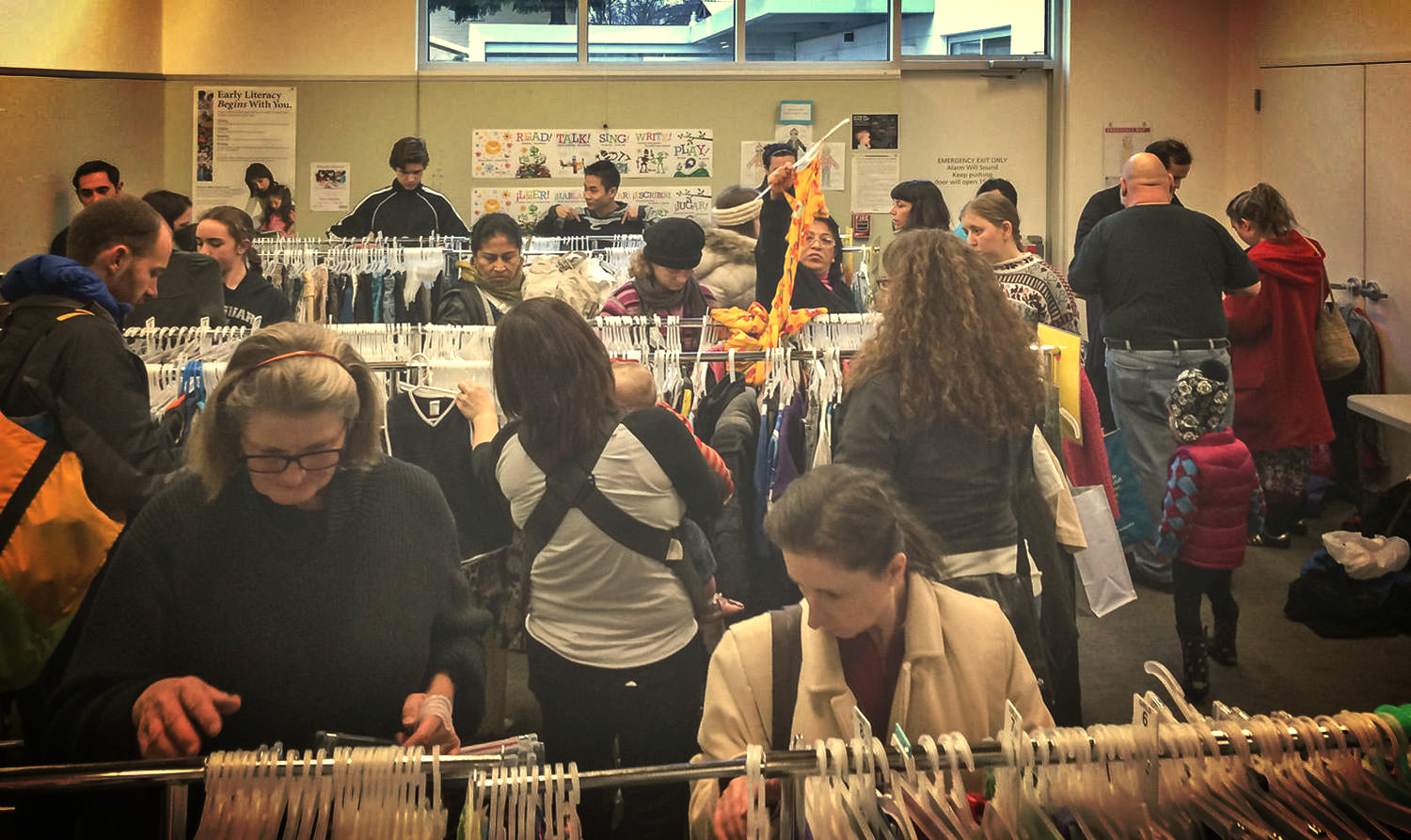 Friendly exchangers fill the community room at North Portland's Kenton Library for the first Free Clothing Exchange of 2015.