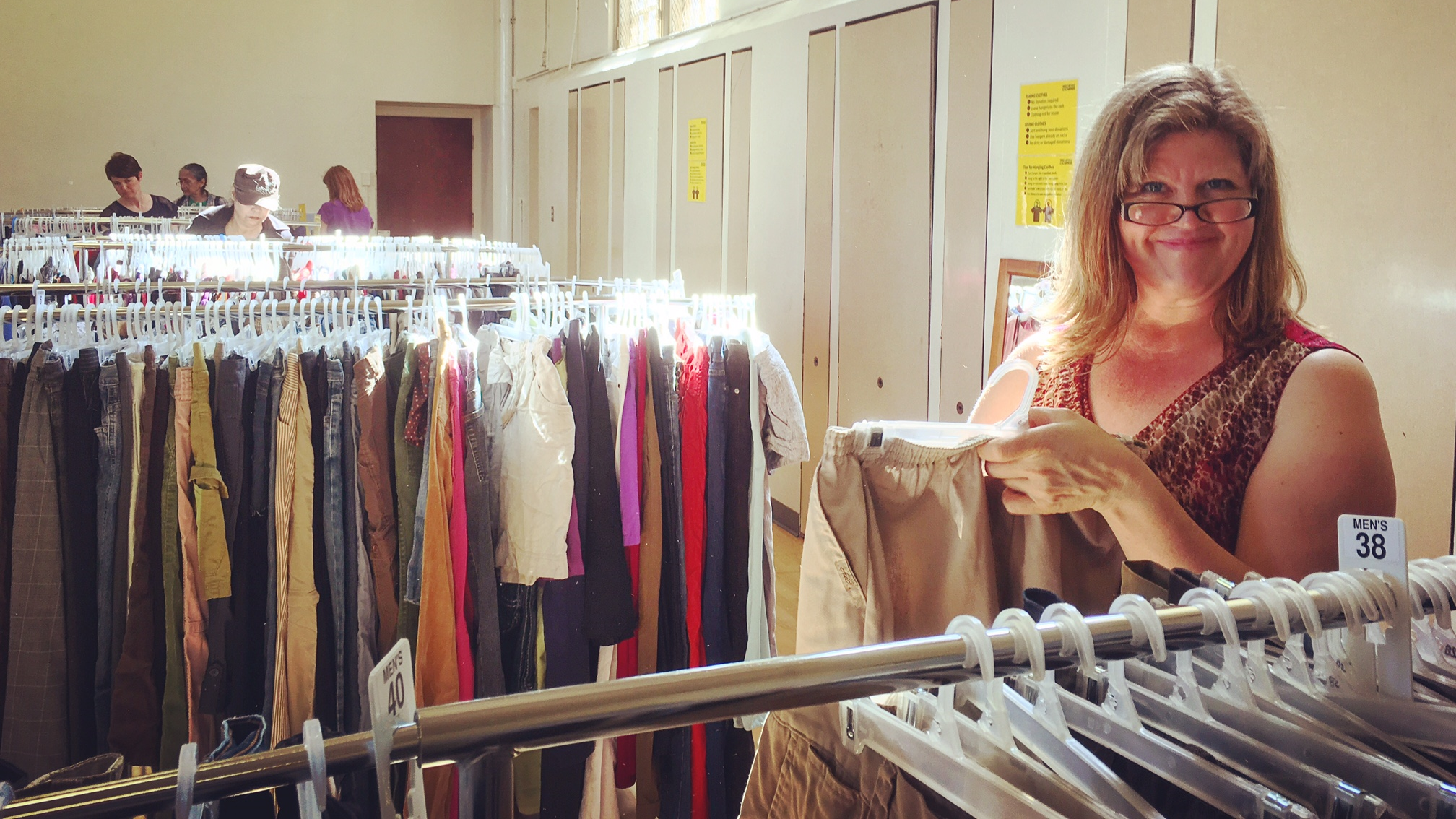 Lori, a Free Clothing Exchange volunteer, helps hang and sort new clothes during FCE's April 3rd relaunch. More than a dozen amazing folks volunteered their time to help plan, set up, sort, greet and tear down during the event.  Thank you all so much!