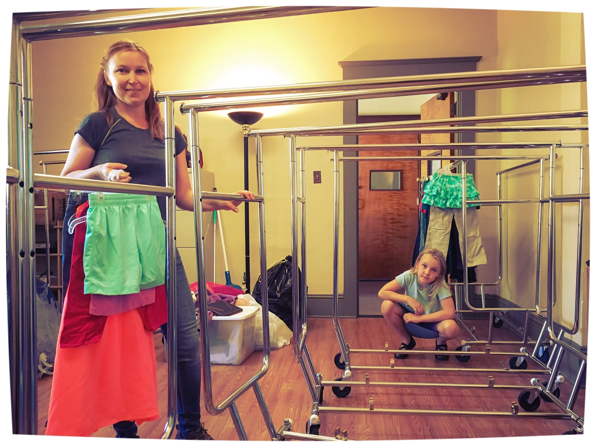 Our first day at FCE HQ: Jenny and Baya setup the racks and get to work sorting the clothes. As far we know, those green shorts are still available.