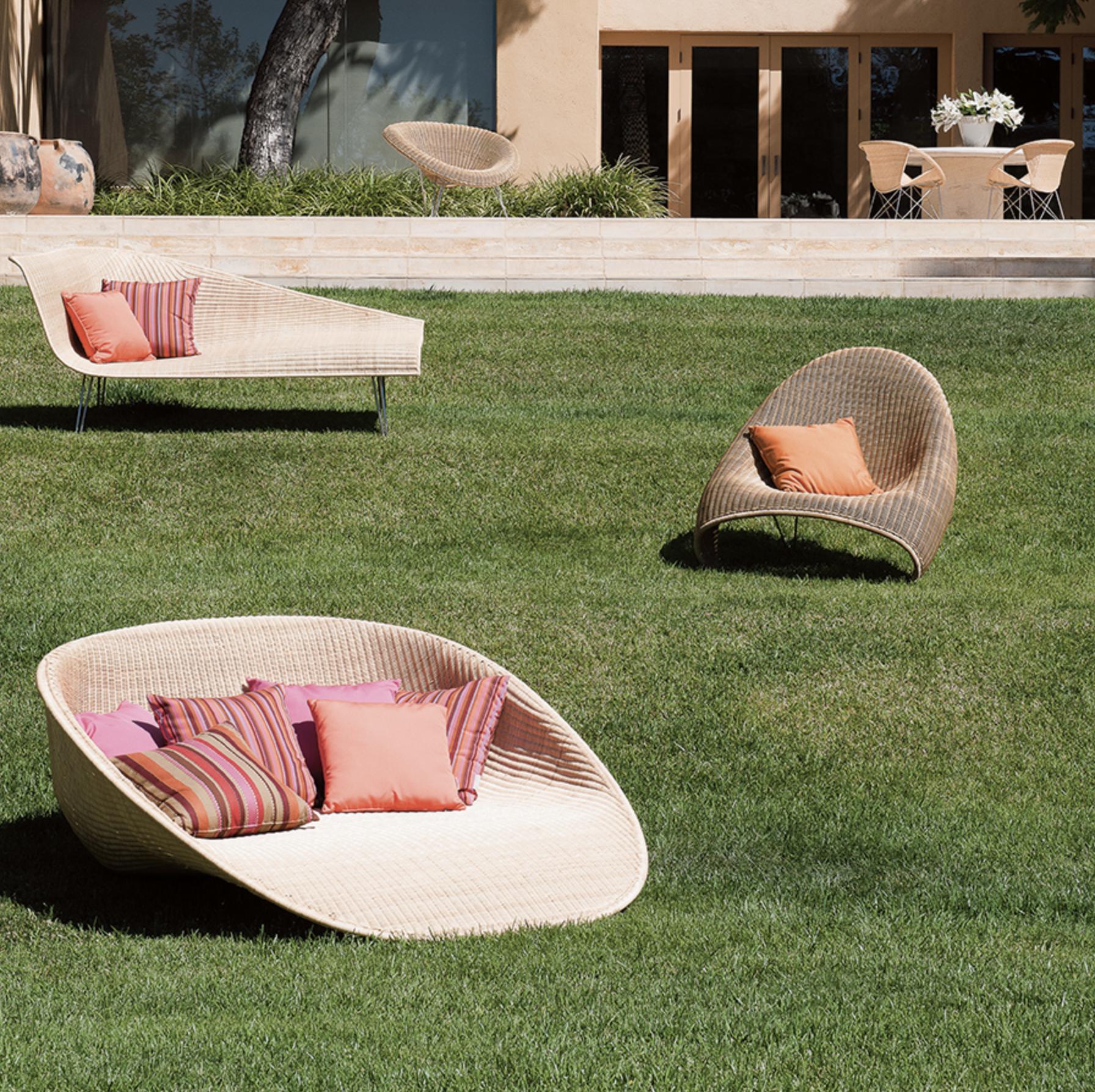 Coral outdoor pillows toned down with warm tones and tan.  Janus et Cie - Fibonacci