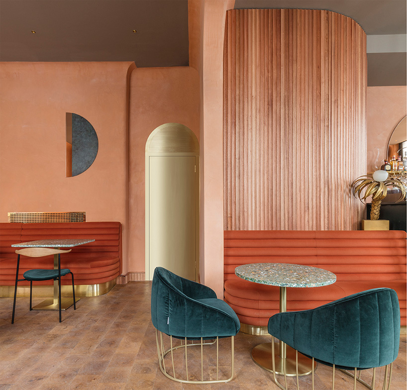 Warm and subdued with neutral wood and deep marine at Omar's Place, London - Sella Concept/Wilson Holloway  (photo by Nicholas Worley)
