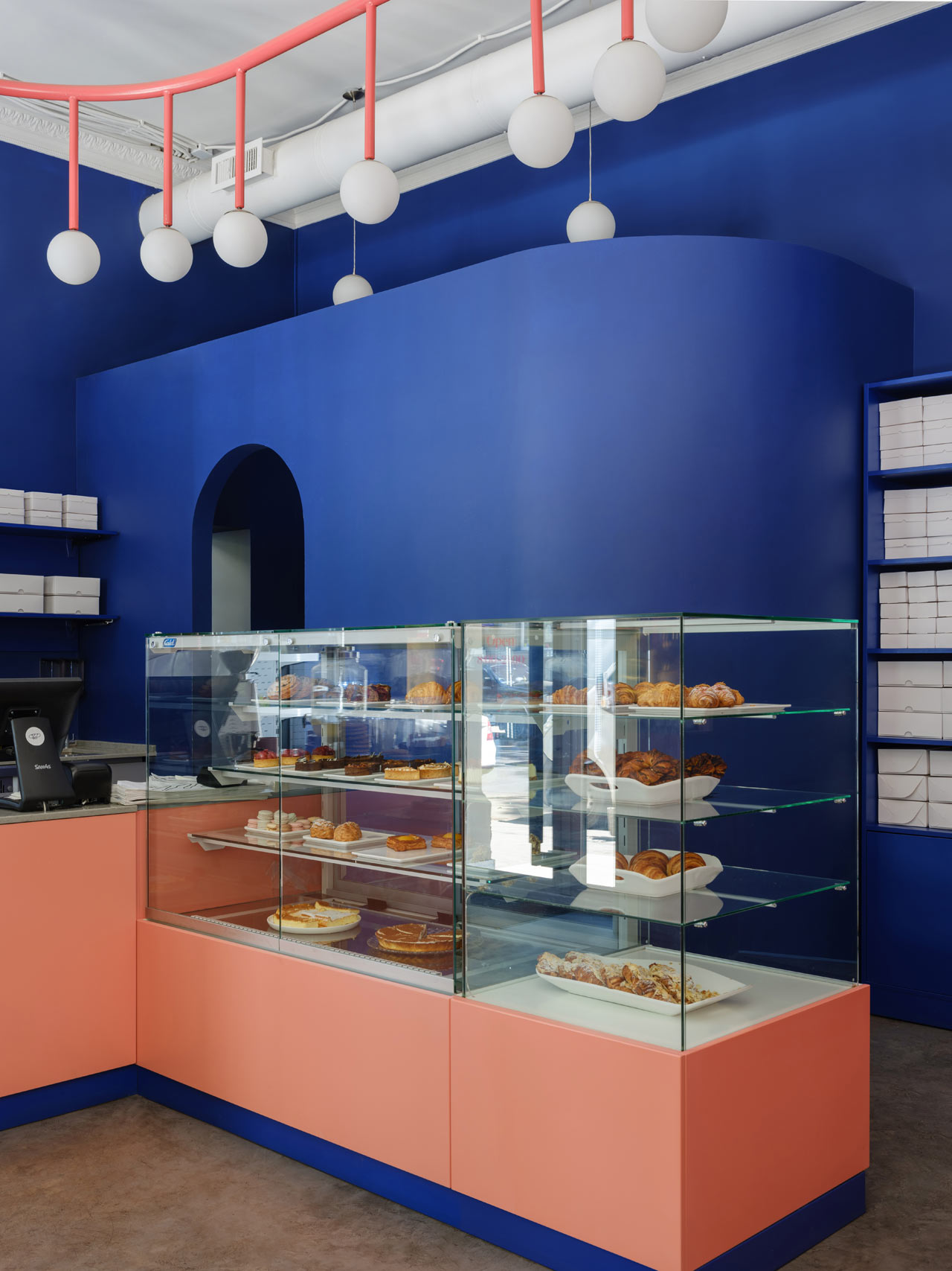 The bakery's sales area has more contrast and each color intensified since they are color wheel opposites.  Breadway café - Odessa, Ukraine