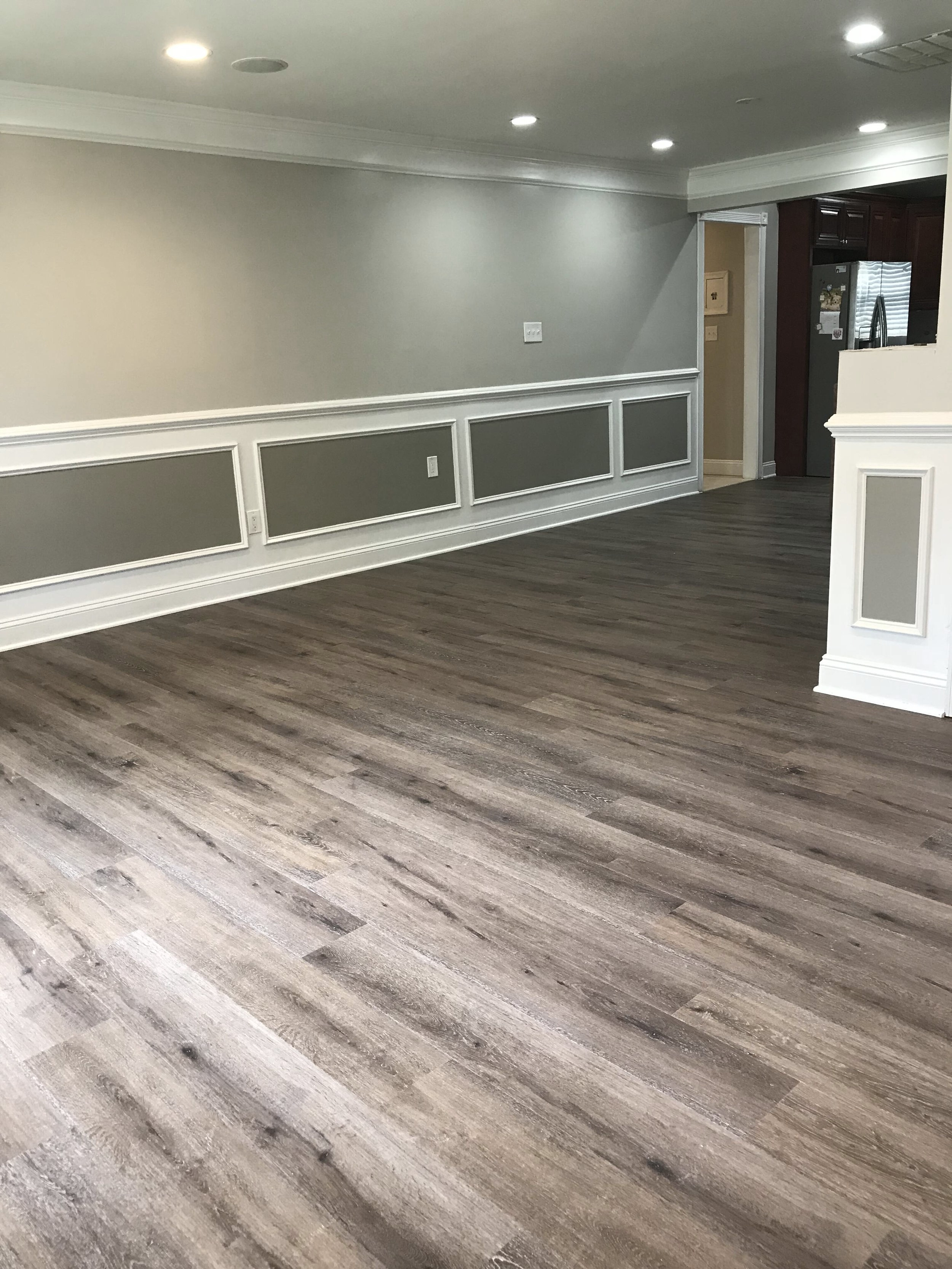 New LVT flooring installed in the living and dining areas, guest bedroom, and gym (below)