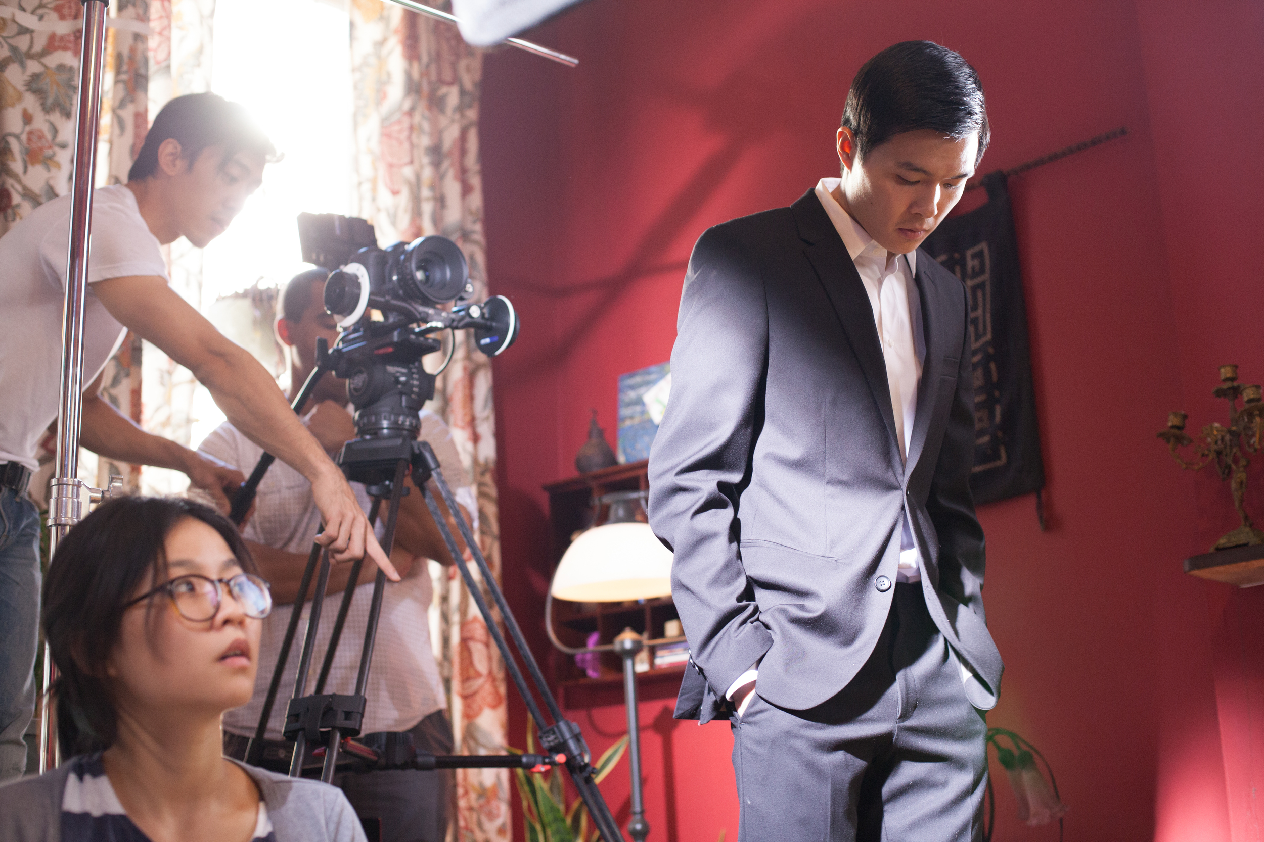 Actor Zilong Zee (Michael) is taking a moment for himself before a take.