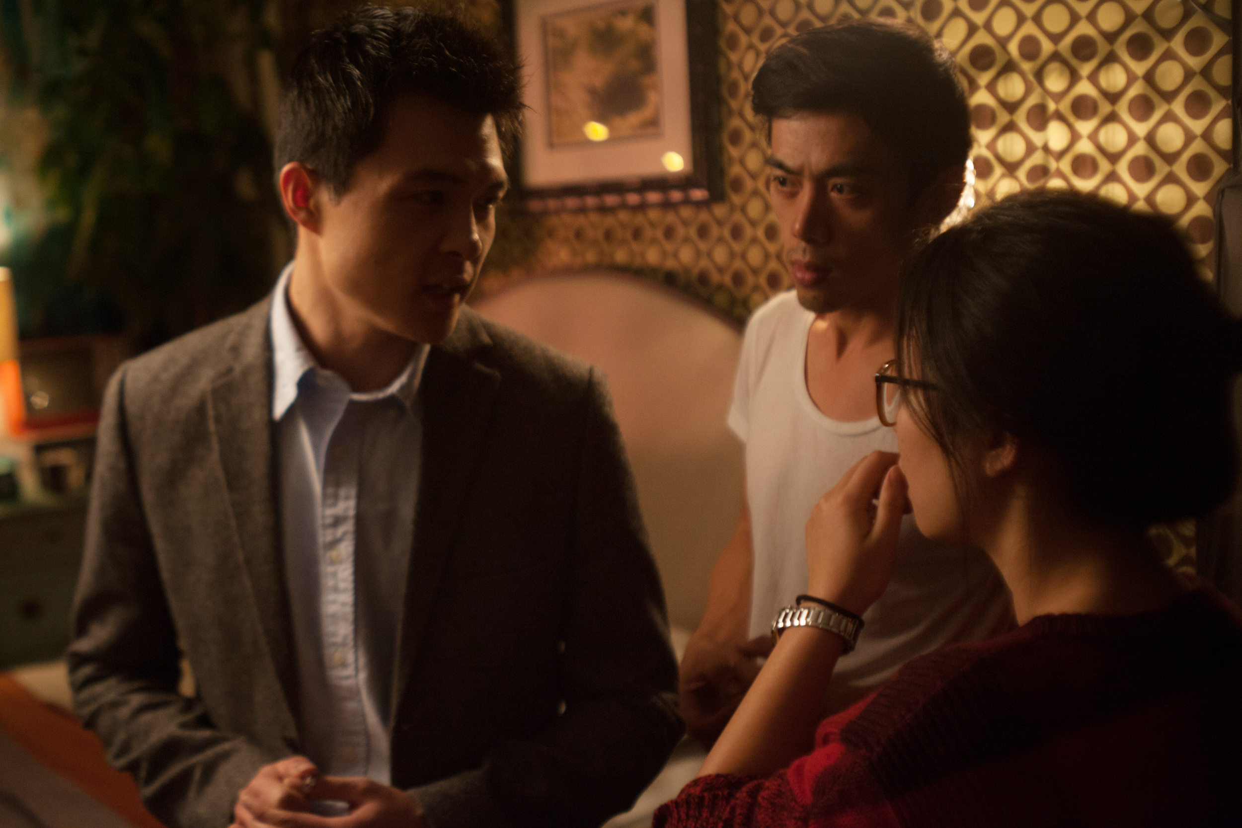 Director Leon Le and AD Qinzhu going over the lines with actor Zilong Zee before a take.