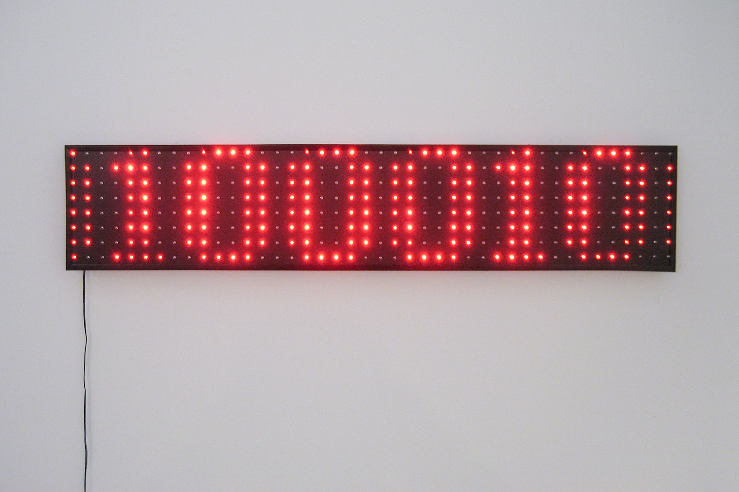 This One Isn't Either    •2006 •Decoded digital image on LED display, digital image on website •7.87 x 43.13 in, 527 x 700 pixels