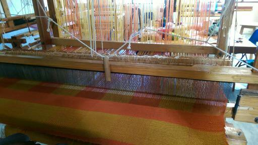 Weaving and loom at Helping Hands. This is a rug in the making.