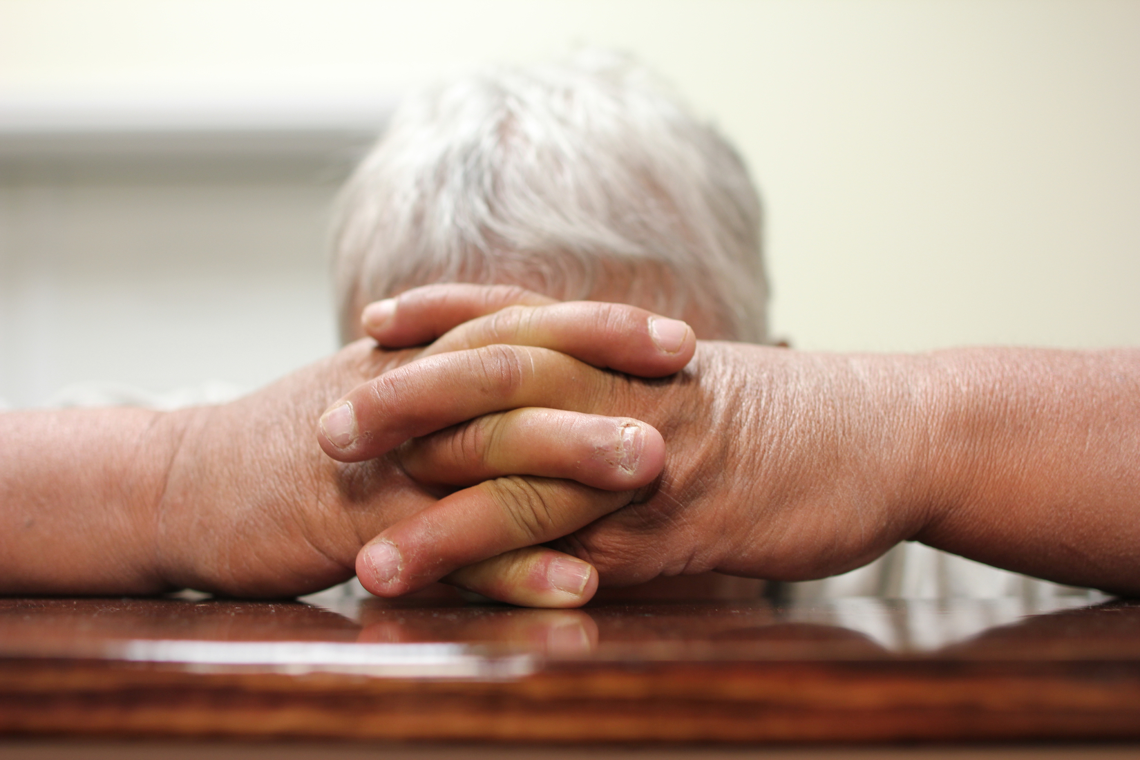 A parishioner kneels to pray at the altar in the Gospel Light Baptist during a Wednesday night service, in Hazard Ky.