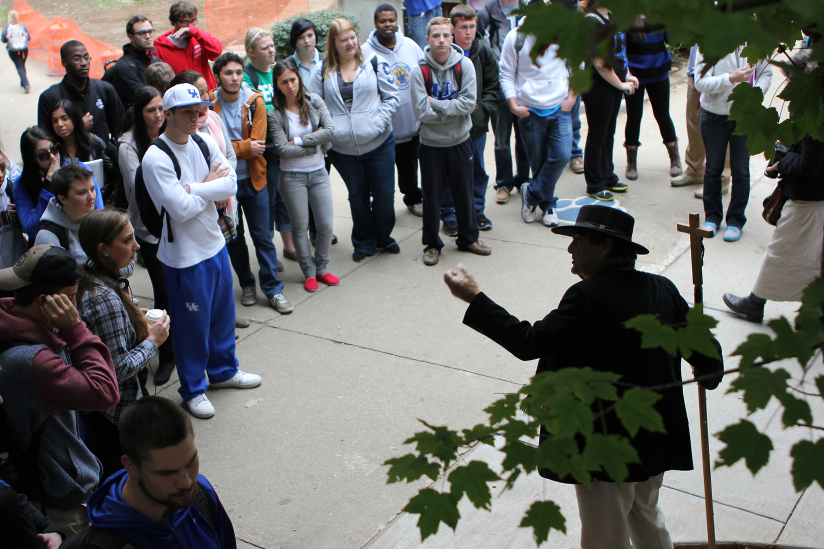 Dozens of students watch on as Brother Jed Smock preaches in the free speech area in front of the University of Kentucky's student center in Lexington, Ky.