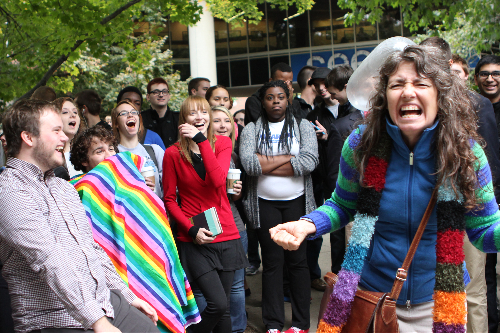 Students, including protesters with the University of Kentucky's LGBT support group the OUTsource, react as an inflated condom collides with Sister Cindy as she delivers a sermon on campus that condemns all sex practices that are not between a married man and woman for the purpose of procreation.