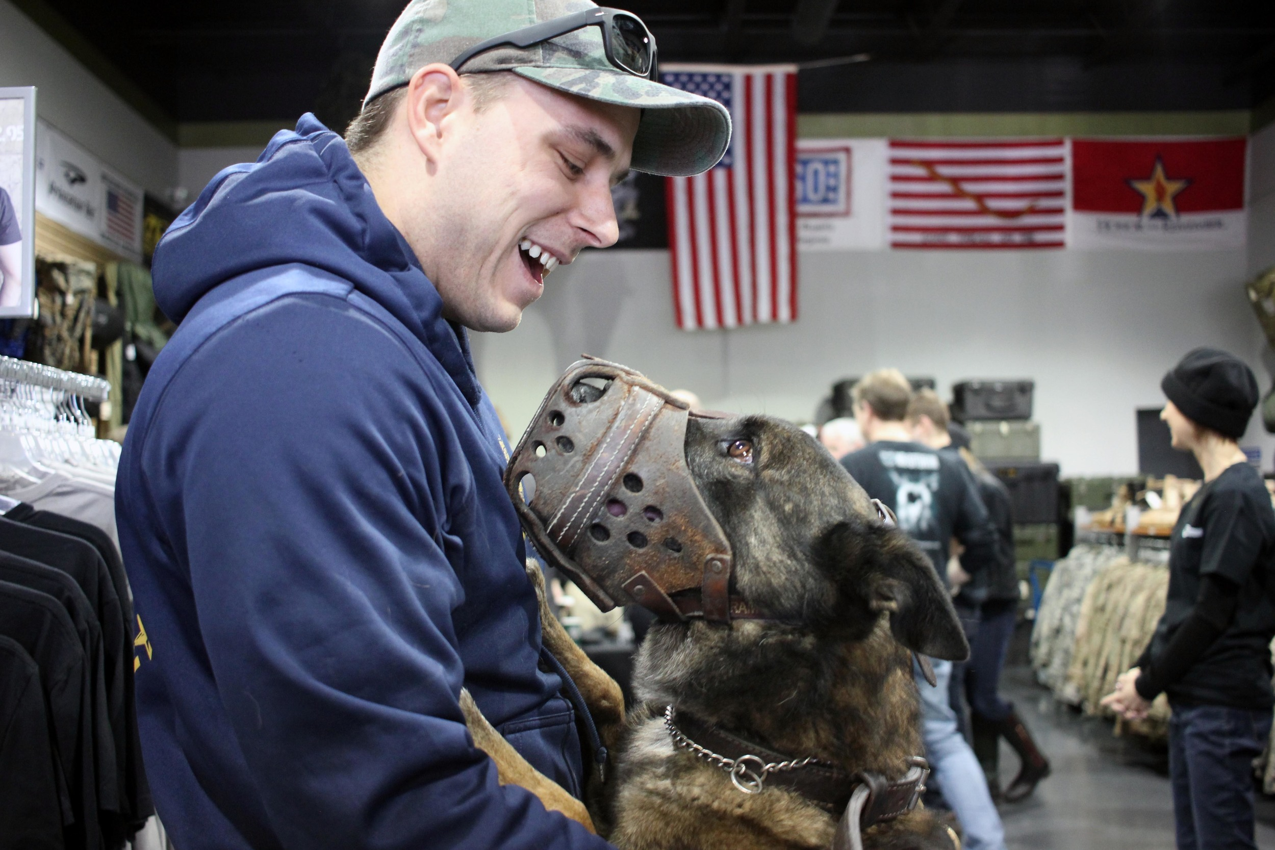 "Norfolk Police Officer Adam Pascoe gives his partner, Badge, a little love after the police dog was fitted for a ballistic vest. About 40 Hampton Roads' K-9 officers were measured for the life saving gear, which they'll receive for free thanks to donors including Anderson Cooper, after one was killed on assignment.    Pascoe often worries about Badge, his best friend, while they're on patrol together, he said.    ""Now I'll worry a little less,"" he said."