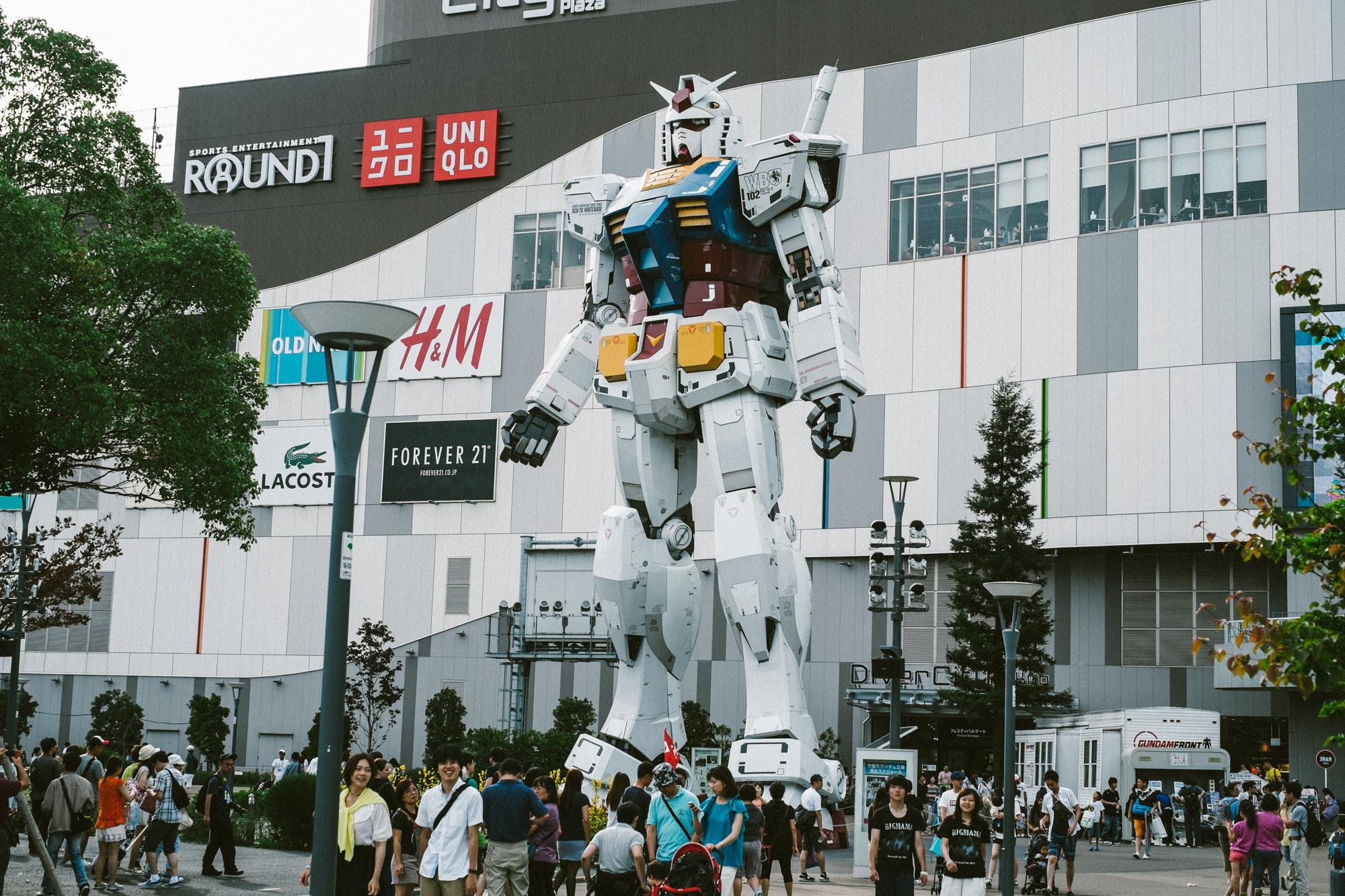 A giant Gundam patrols Odaiba.