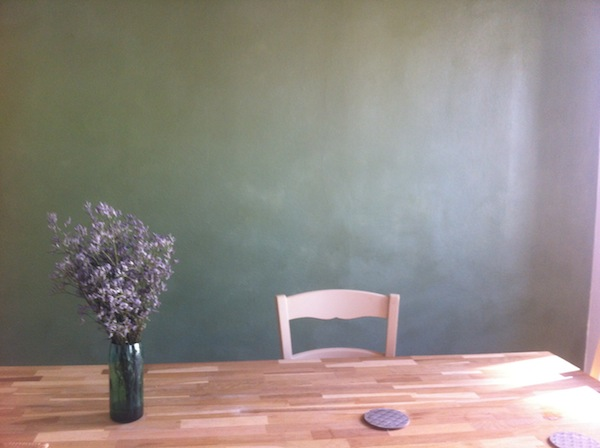 The dining room of My Paris Apartment, with its famous green wall