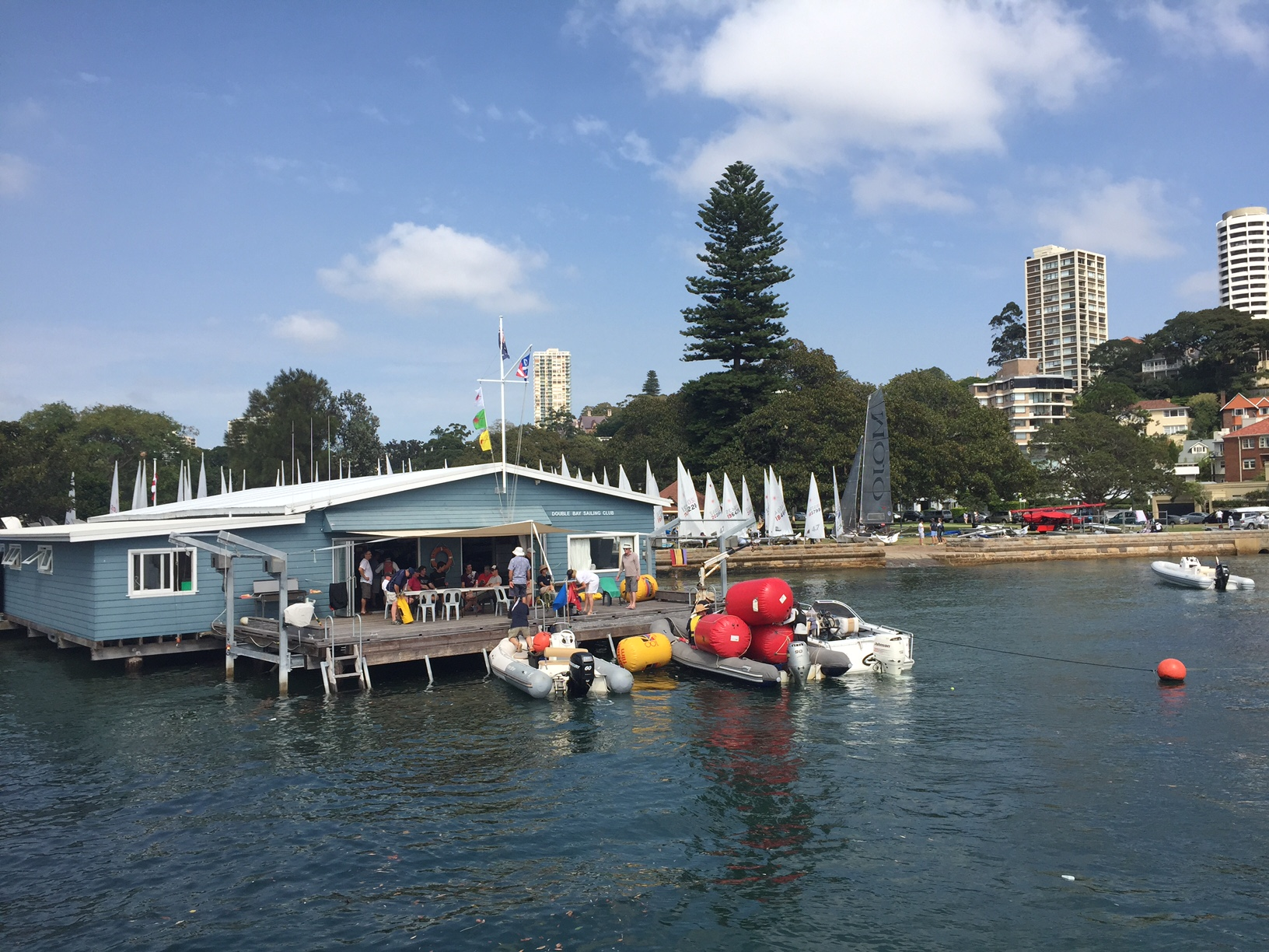 Nothing finer than a well populated DBSC Clubhouse in the sun, rescue boats at the ready and over 100 Lasers in the park
