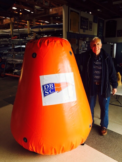 A newer buoy with an older boy
