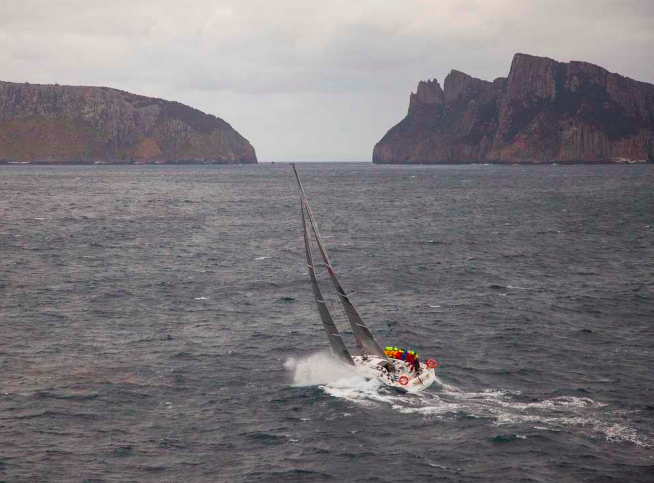 Still racing, still 40nm from Hobart, but off the Tasman peninsula (right) and Tasman Island (left), 30/12/2012. Breakthrough was 27th in a fleet of 100. Jonathan is is the one in the yellow hood.
