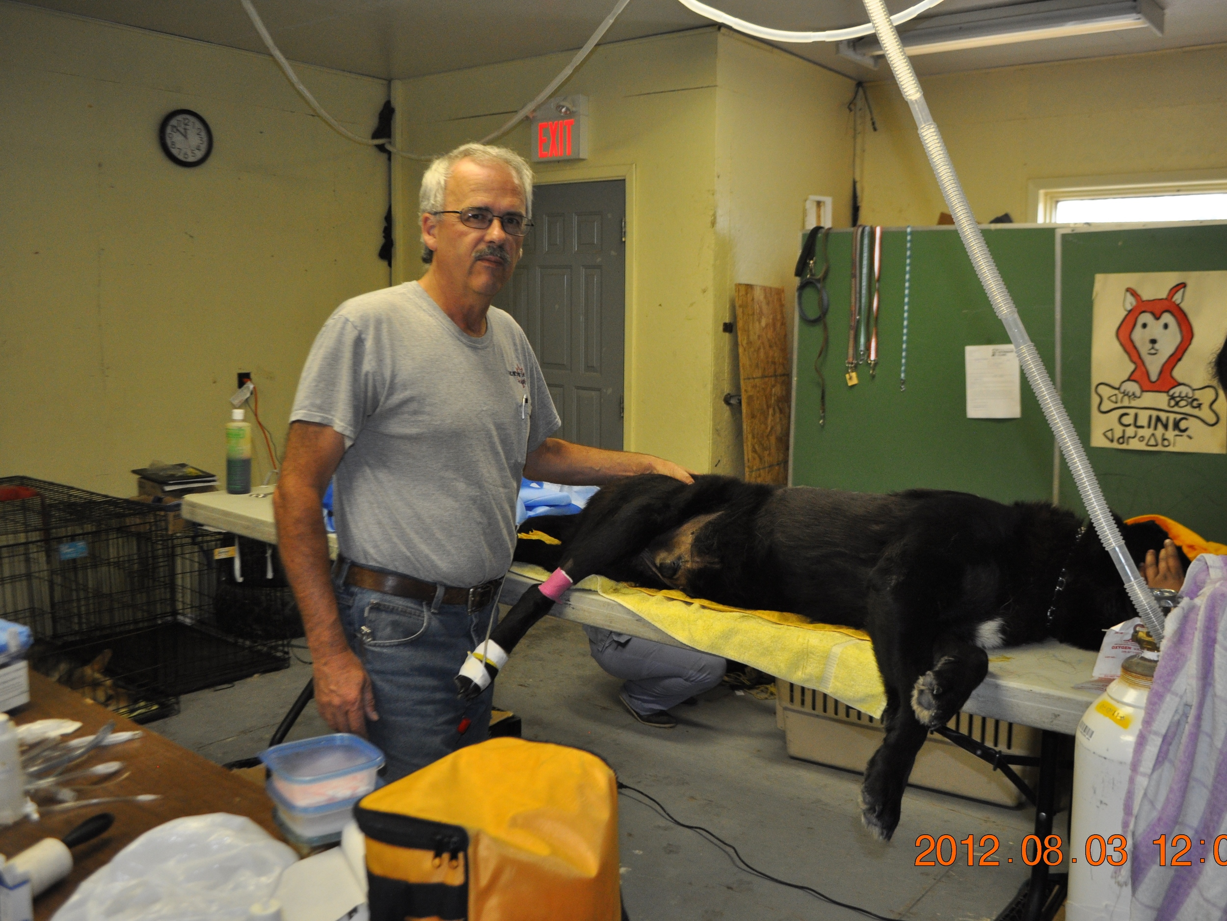 Ron Brent with dog on table.JPG