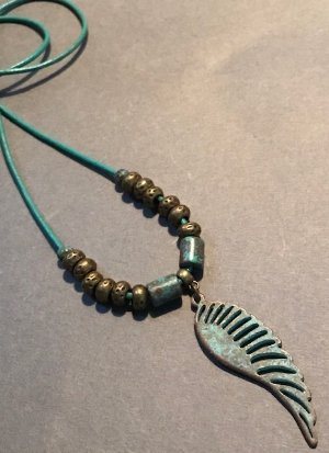 """single wing of thought  #0111 $35     the simplicity of the single green patina wing allows us to pause and causes us to recall a time of contentment that was well spent. length of turquoise leather cord is 20""""."""