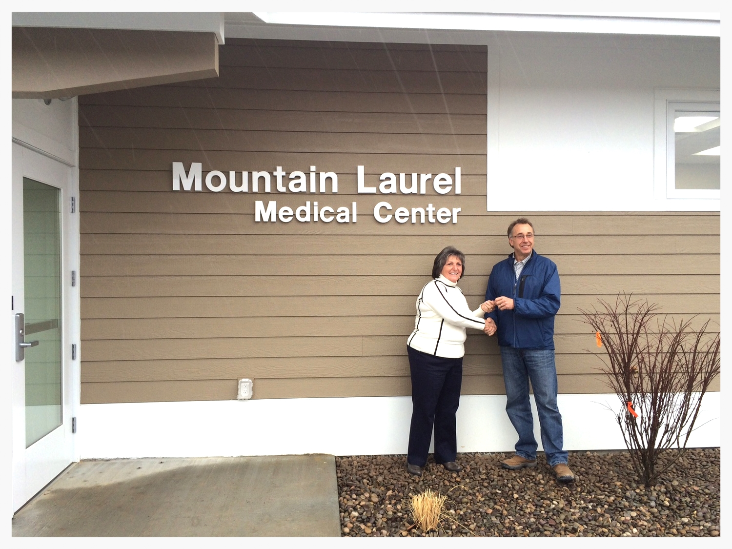 Jeff Gosnell handing over the keys to Beth Little Terry, Mountain Laurel's CEO