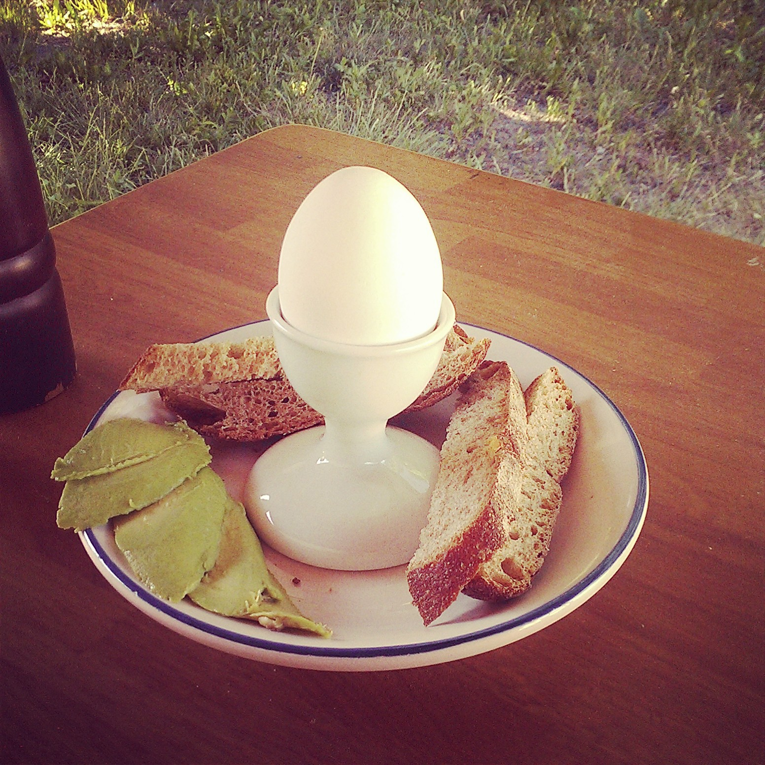 Soft-boiled egg with toast and avocado