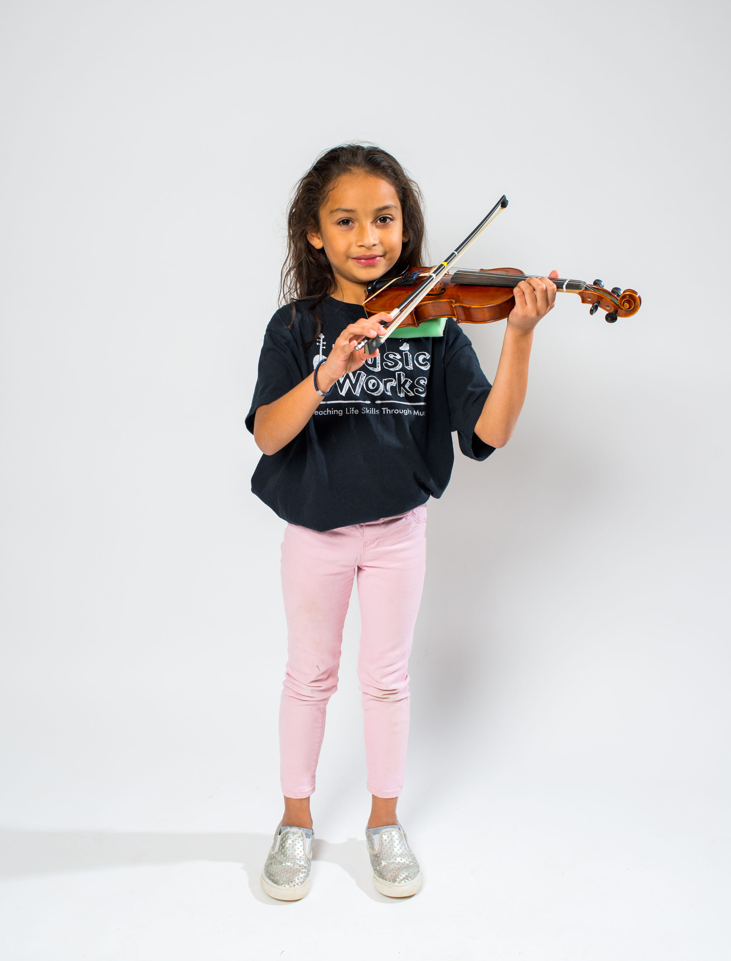 "Fostering Growth - ""I believe the program helps in so many ways. Our children have grown in self esteem, maturity, and responsibility. As a metaphor for life, they have learned how to value and take care of their instruments. They know how to be part of a team (musical sections), and they have learned how to solo. They are better able to comfortably comport themselves in a truly responsible fashion in person, on the stage of life, and even when they think no one is looking. It has enhanced their ability to make positive choices for themselves.""Hadley, dad of Alex and Ellison"