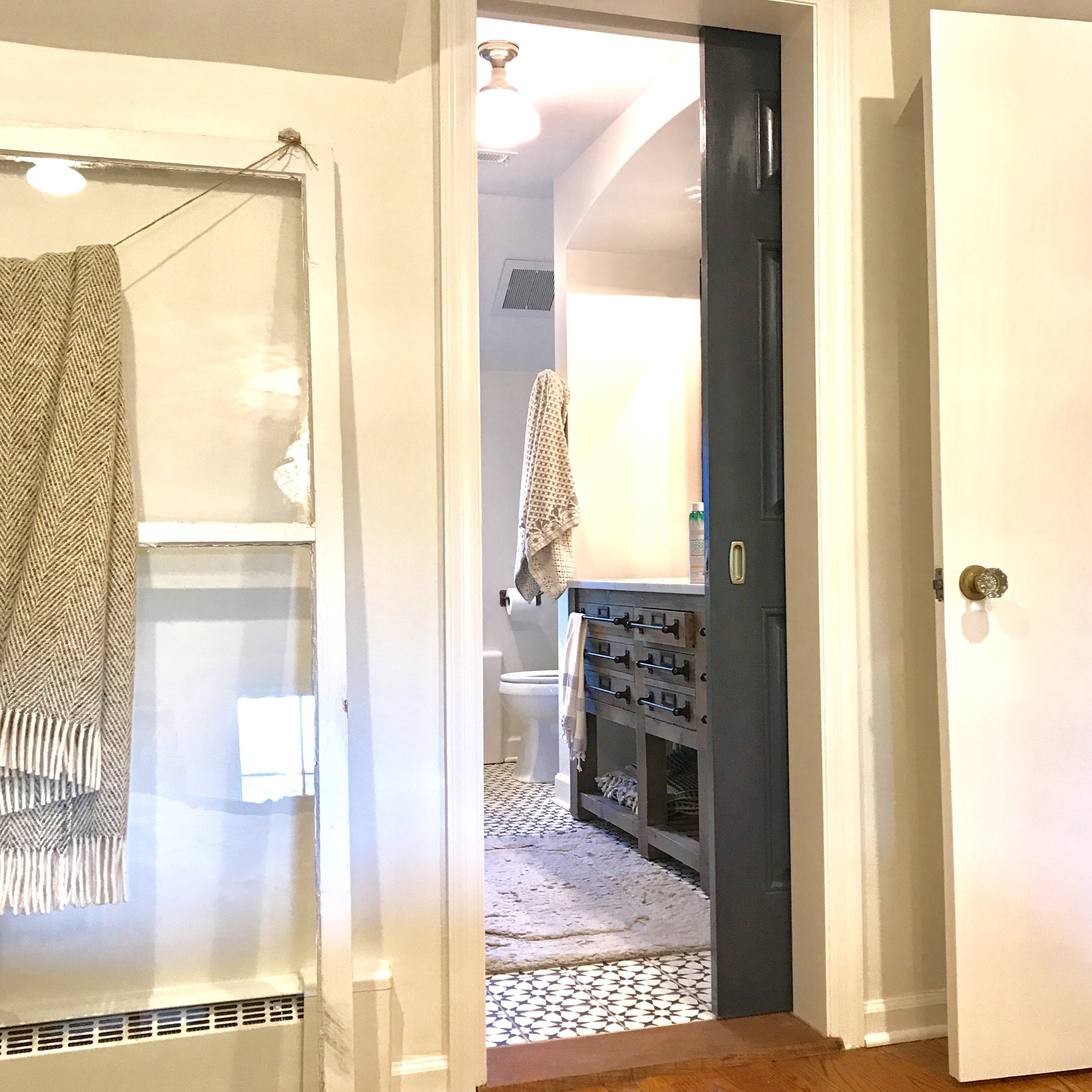One untouched space makes a renovation a little easier. Like Jessica's beautiful master bathroom (hello, amazing tile floor.).