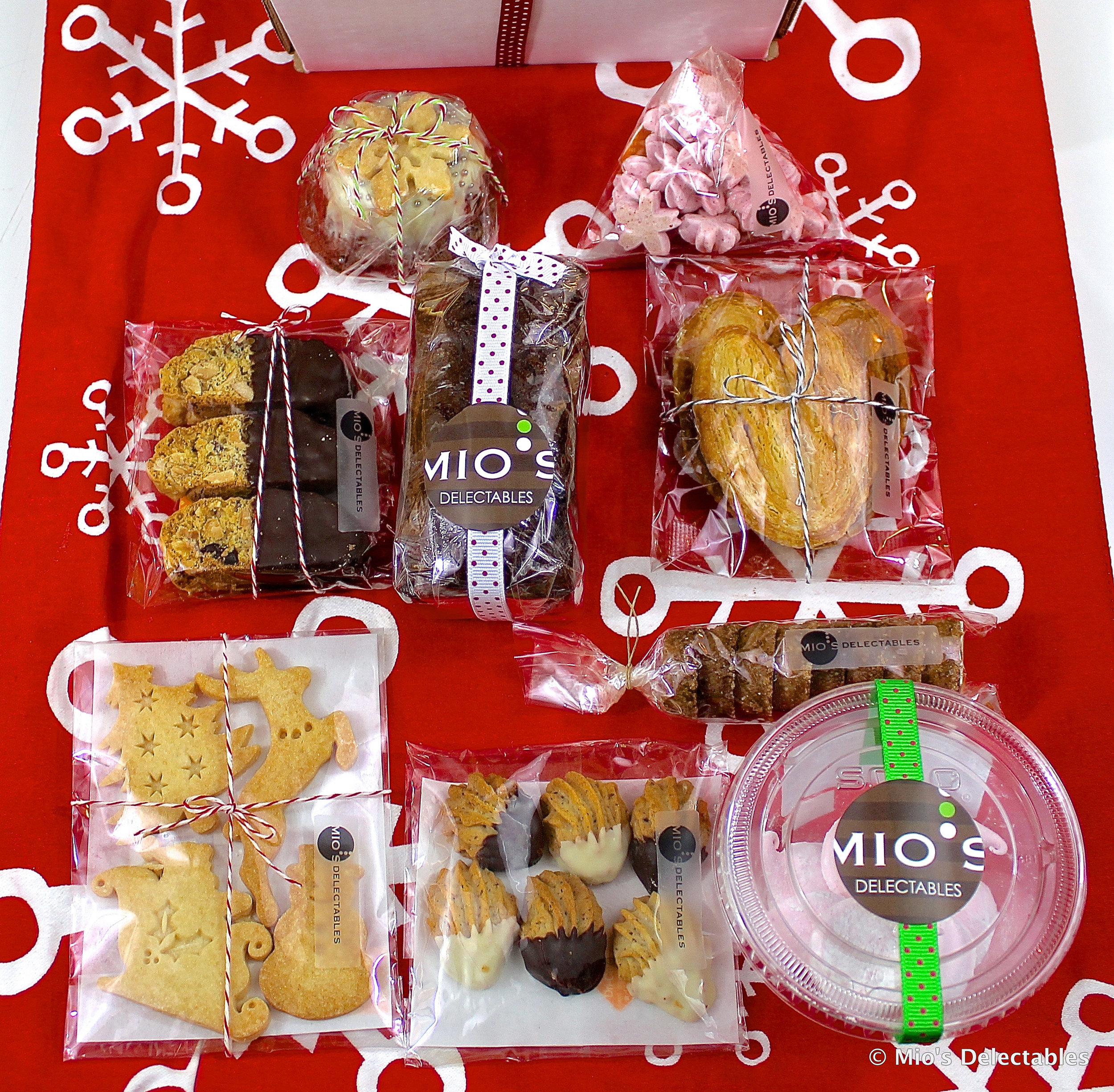 SOLD OUT  *Holiday Special Gift Box $29.75  Mulberry Salted Chocolate Ginger & Cranberry Pound Cake x1   Chocolate Dipped Cranberry Biscotti x3  Hazelnut Chocolate Shell Cookies x6  Palmier x2  Mio's Delectables Signature Holiday Spiced Shortbread Cookies x1  Christmas Butter Cookies x1  Petite Gâteau Au Chocolat w/ White Chocolate x1  Red Currant Guimauvex1  Cranberry Meringue Cookies x1    https://www.miosdelectables.com/christmas-cake-preorder/mios-delectables-2018-holiday-gift-box