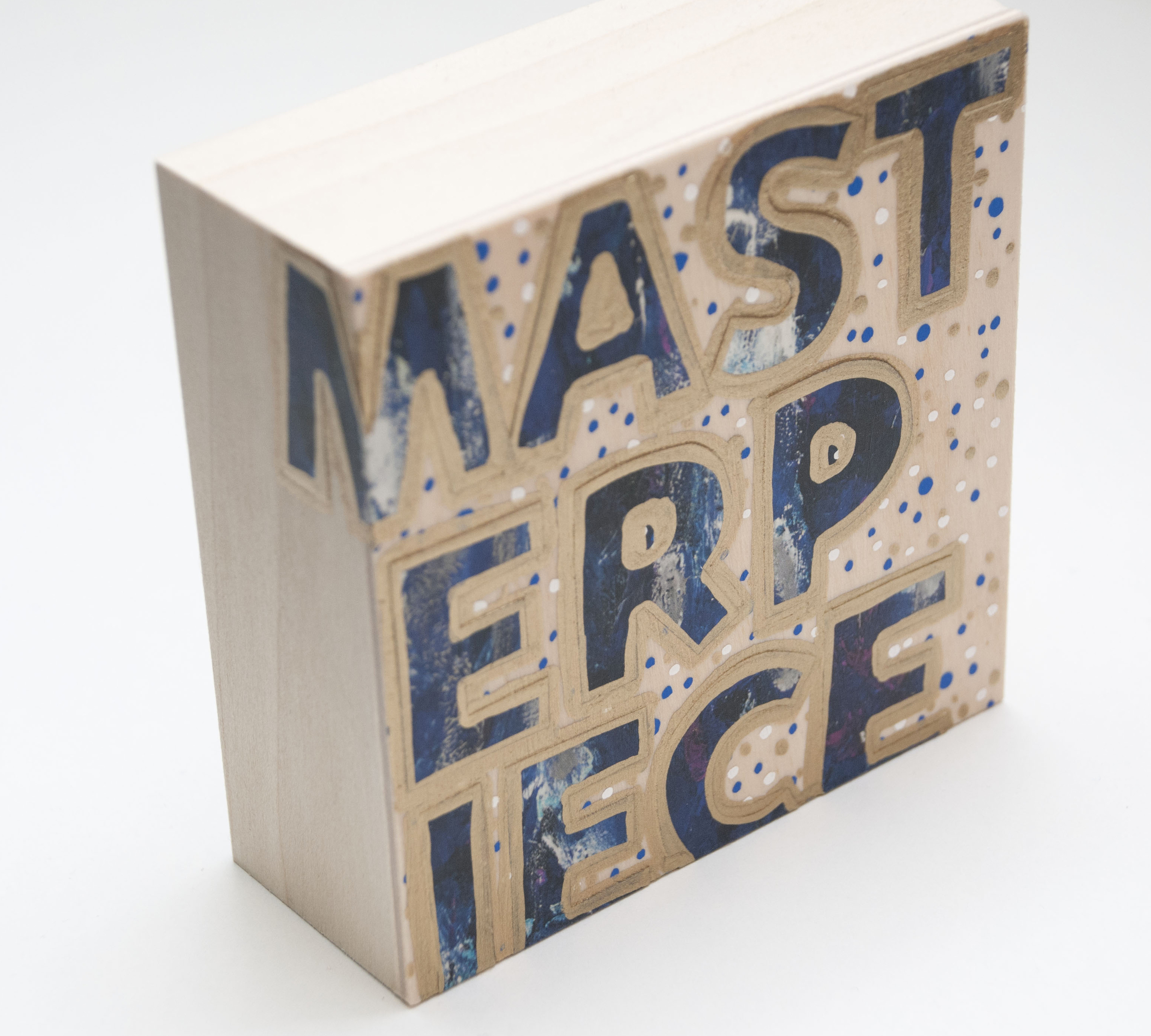 Masterpiece , 2015 Acrylic, enamel, and catalog pages on wood 4 x 4 x 1 5/8 inches