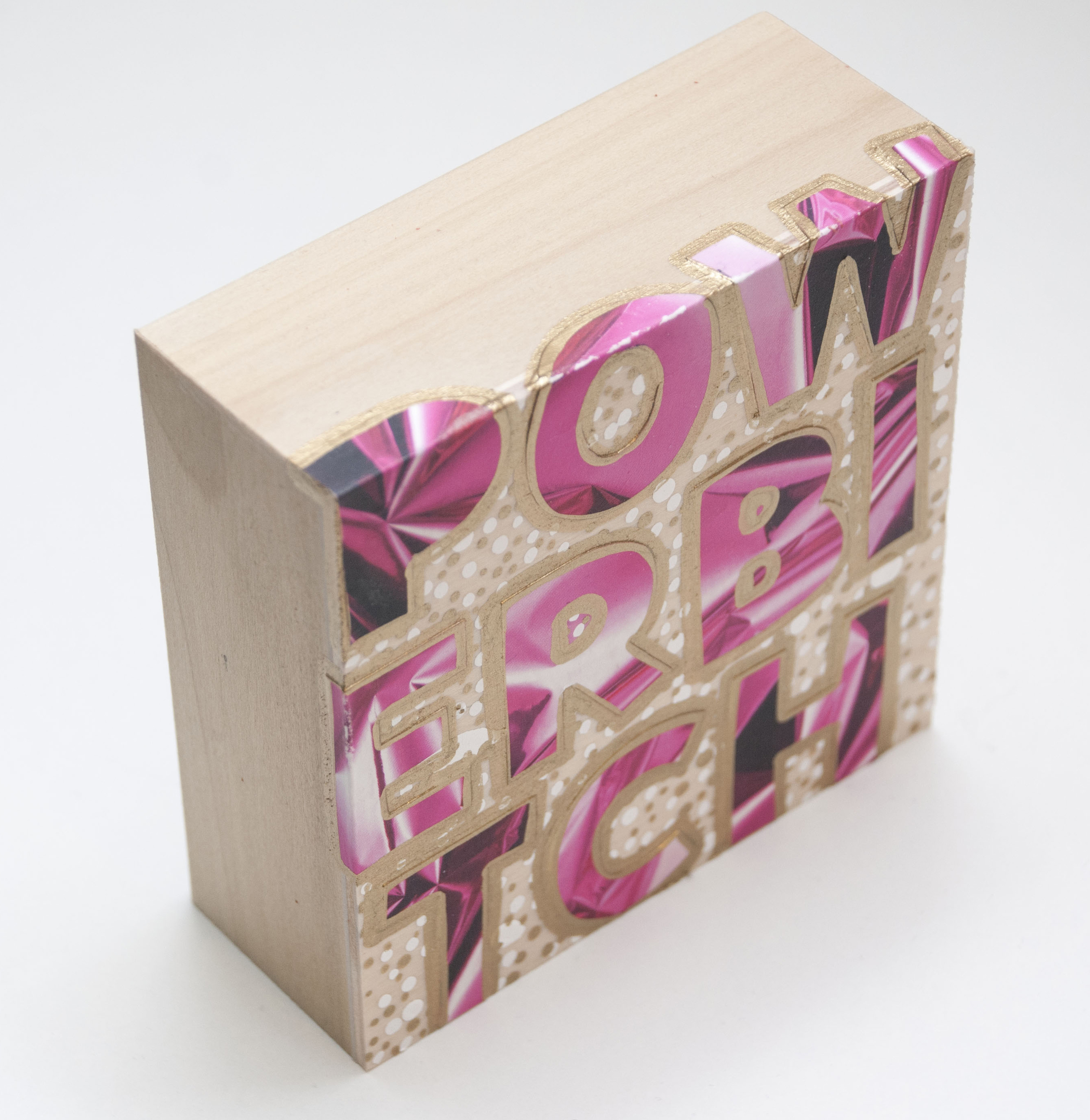 Powerbitch , 2016 Acrylic, enamel, and catalog pages on wood 4 x 4 x 1 5/8 inches