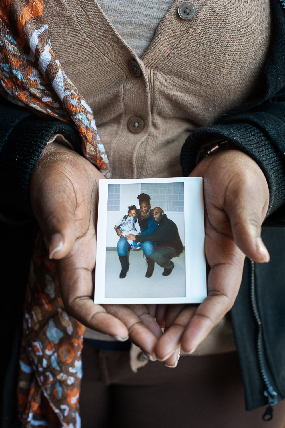 Candis holding one of the precious prison polaroids, the only pictures people have of their loved ones on the inside. This picture is showing her with her husband and her daughter. March 26, 2014.